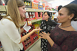 Penny Gushiken (left) leads a cultural orientation class for newly arrived refugees in Lancaster, Pennsylvania. During a visit to a supermarket, participants discuss available food items, including ketchup. The class is sponsored by Church World Service. <br /> <br /> Photo by Paul Jeffrey for Church World Service.