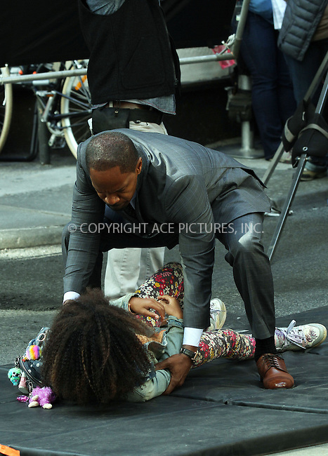 WWW.ACEPIXS.COM<br /> <br /> September 25 2013, New York City<br /> <br /> Actors Jamie Foxx and Quvenzhan&eacute; Wallis on the set of the new movie 'Annie' on September 25 2013 in New York City<br /> <br /> By Line: Zelig Shaul/ACE Pictures<br /> <br /> <br /> ACE Pictures, Inc.<br /> tel: 646 769 0430<br /> Email: info@acepixs.com<br /> www.acepixs.com