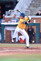University of North Carolina Greensboro (UNCG) Spartans first baseman Josh Madole (6) swings at a pitch during a game against the Tennessee Volunteers at Lindsey Nelson Stadium on February 24, 2018 in Knoxville, Tennessee. The Volunteers defeated Spartans 11-4. (Tony Farlow/Four Seam Images)