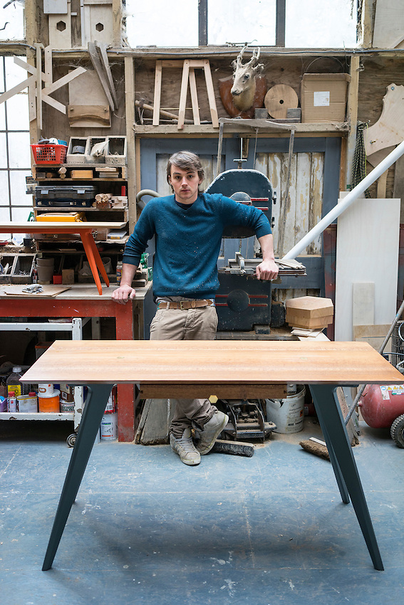 Ted Jefferis in his studio with His one of his tables.