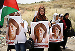 Palestinian protesters hold portraits of Khalida Jarrar, a member of the Popular Front for the Liberation of Palestine (PFLP) jailed in Israeli prisons, during a protest demanding for her release from Israeli jails, outside Ofer Israeli military prison, near the West Bank city of Ramallah on May 28, 2015. Photo by Shadi Hatem Palestinian protesters hold portraits of Khalida Jarrar, a member of the Popular Front for the Liberation of Palestine (PFLP) jailed in Israeli prisons, during a protest demanding for her release from Israeli jails, outside Ofer Israeli military prison, near the West Bank city of Ramallah on May 28, 2015. Photo by Shadi Hatem