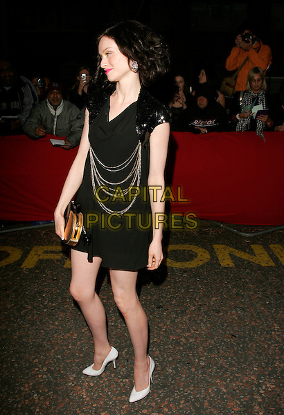 SOPHIE ELLIS BEXTOR.Arrivals - Greatest Britons 2007 Awards Show, .The London Studios, London, Engand, May 21st 2007. .full length black mini dress silver chains sequined shoulders gold bag purse white shoes.CAP/AH.©Adam Houghton/Capital Pictures.
