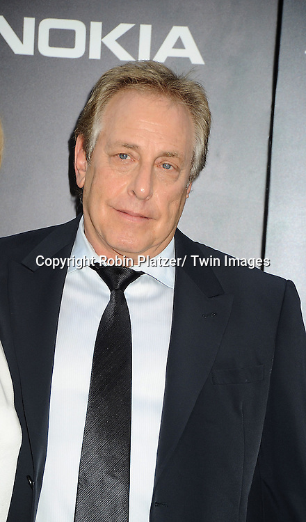 "Charles Roven attends the world premiere of ""The Dark Knight Rises"" on .July 16, 2012 at The AMC Lincoln Square Imax Theatre in New York City. The movie stars Christian Bale, Gary Oldman, Anne Hathaway, Tom Hardy, Marion Cotillard, Joseph Gordon-Levitt and Morgan Freeman."