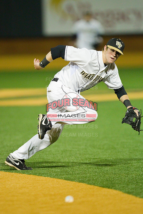 Second baseman Conor Keniry #14 of the Wake Forest Demon Deacons can't quite get to this ground ball against the North Carolina Tar Heels at Gene Hooks Field on March 11, 2011 in Winston-Salem, North Carolina.  Photo by Brian Westerholt / Four Seam Images