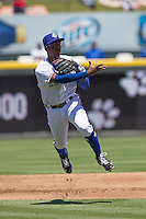 Round Rock shortstop Jurickson Profar (10) makes a running throw to first base against the Nashville Sounds in the Pacific Coast League baseball game on May 5, 2013 at the Dell Diamond in Round Rock, Texas. Round Rock defeated Nashville 5-1. (Andrew Woolley/Four Seam Images).