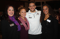 NWA Democrat-Gazette/CARIN SCHOPPMEYER Janine Mozee (from left), Isabella Carr, Austin Carr, Burlsworth Trophy finalist, and Bianca Carr gather for a photo Dec. 4.