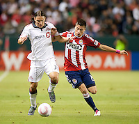 CARSON, CA – OCTOBER 9: Toronto FC defender Maksim Usanov (33) and Chivas USA midfielder Jorge Flores (19) during a soccer match at Home Depot Center, October 9, 2010 in Carson California. Final score Chivas USA 3, Toronto FC 0.