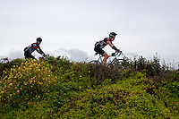 Bike riders, participants in the annual AIDS/Lifecycle Ride to End AIDS, along Highway 1 south of San Francisco.