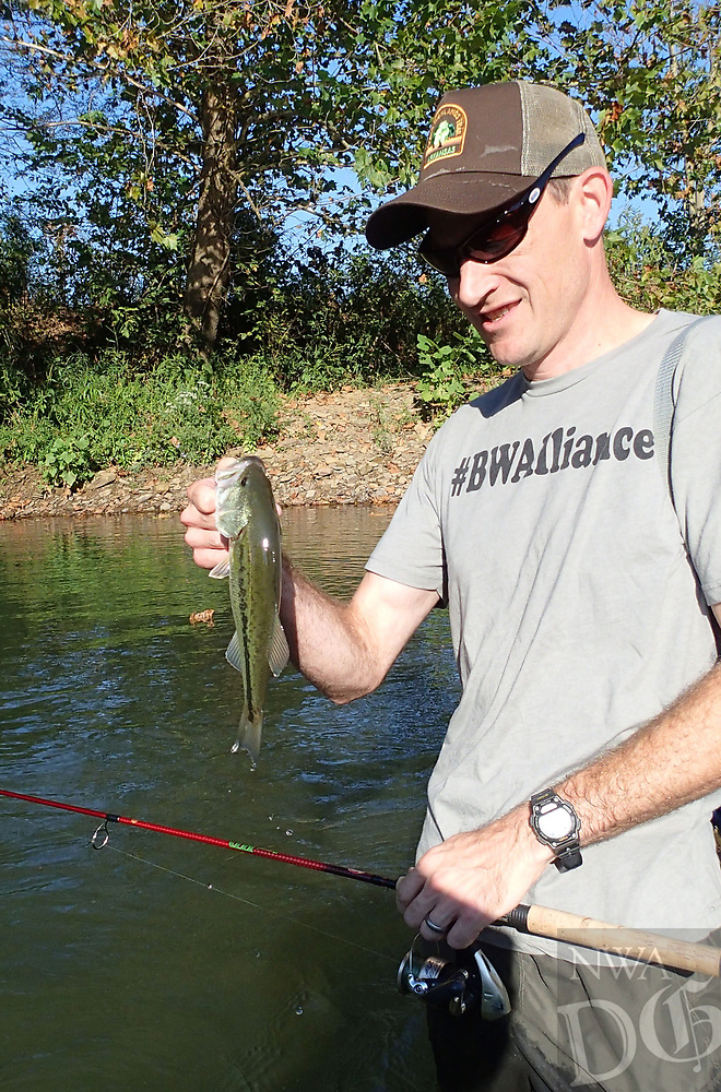 NWA Democrat-Gazette/FLIP PUTTHOFF<br />John Pennington catches a largemouth bass Sept. 22 2017 while wading the Middle Fork of the White River.