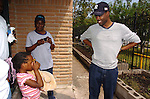 Actor/Comedian Chris Rock has his photo taken by  Hurricane Katrina evacuee Jarlai Morris,age 6, while on a visit to the Bonita House in Houston,Texas Thursday Sept. 29,2005.(Dave Rossman/For the Chronicle)