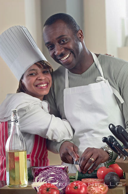 African American couple cooks meal at home