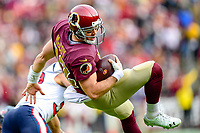 Landover, MD - November 18, 2018: Washington Redskins quarterback Colt McCoy (12) is send airborne after a tackle by Houston Texans defensive end J.J. Watt (99) during second half action of game between the Houston Texans and the Washington Redskins at FedEx Field in Landover, MD. The Texans defeated the Redskins 23-21. (Photo by Phillip Peters/Media Images International)