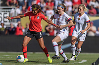 CHICAGO, IL - OCTOBER 06: Cho So Hyun #8 and Tierna Davidson #12 of the United States during a game between the USA and Korea Republic at Soldier Field, on October 06, 2019 in Chicago, IL.