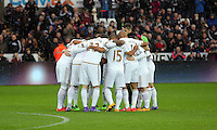 Swansea players huddle before the Barclays Premier League match between Swansea City and Crystal Palace at the Liberty Stadium, Swansea on February 06 2016