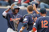 Ivory Thomas #11 of the Cal. St. Fullerton Titans is greeted by teammates after scoring against the Cal. St. Long Beach 49'ers at Goodwin Field in Fullerton,California on May 14, 2011. Photo by Larry Goren/Four Seam Images