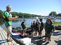 Patrick Mulhern (left) gives direction to the scouts before they start paddling across to Burlington Island along the Delaware River Sunday, July 30, 2017 in Burlington, New Jersey. Andrew Stillman, and his scout troop rowed to Burlington Island  to install posts with steel markers for his Eagle Scout project. They installed the posts with trail numbers at various trails to mark the trails. Until now, emergency services and the city's officials worry has been that a call for help (injury, illness) could delay response because of the size of the Island and the growth. With the trail markers - the city has helped map those trails out- EMS and the marine police will have a better chance to quickly locate someone in trouble. (Photo by William Thomas Cain)