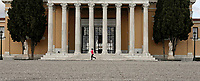 Pictured: A woman jogs in the Zappeio Park.<br /> Re: Police patrol the streets to enforce the measures of self-isolation in an effort to fight the Coronavirus Covid-19 pandemic in Athens, Greece.