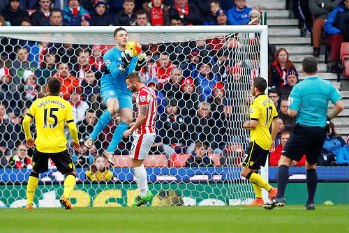 27.02.2016. Britannia Stadium, Stoke, England. Barclays Premier League. Stoke City versus Aston Villa. Jack Butland of Stoke City catches the ball in the air in front of Bardsley