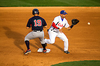Sports Action photography of the USA Collegiate National Team and Cuba&rsquo;s National team at BB&amp;T Ballpark in Uptown Charlotte, NC. <br /> <br /> Charlotte Photographer - PatrickSchneiderPhoto.com