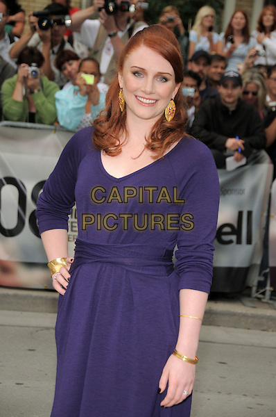 "BRYCE DALLAS HOWARD .""The Loss Of A Teardrop Diamond"" Premiere held at Roy Thomson Hall during the 33rd Annual Toronto International Film Festival, Toronto, Ontario, Canada, .12 September 2008..half  length blue dress hand on hip long sleeves .CAP/ADM/BPC.©Brent Perniac/Admedia/Capital Pictures"