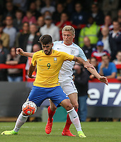 Felipe Vizeu of Brazil holds off Taylor Moore (Bristol City) of England during the International match between England U20 and Brazil U20 at the Aggborough Stadium, Kidderminster, England on 4 September 2016. Photo by Andy Rowland / PRiME Media Images.