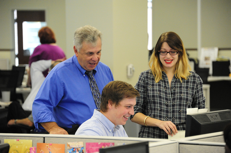 Tim Martin AME News for the Pittsburgh Post-Gazette retires September 25, 2015.<br /> <br /> Martin works with paginators Tyler Pecyna (cq) and Emily Dobler.