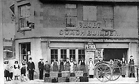 BNPS.co.uk (01202 558833)<br /> Pic: ShaftesburyHistoricalSociety/BNPS<br /> <br /> Pictured: Workers pose in front of 'Short Coach Builders'. The building has now been demolished where there is now a Post Office.<br /> <br /> These charming photos reveal everyday life at the turn of the 20th century in a thriving market town later made famous by a TV advert.<br /> <br /> The black and white snapshots of Shaftesbury, Dorset, were taken by Albert Tyler who set up a photography business there in 1901.<br /> <br /> There are various street scenes and also images of the locals in traditional attire, with men in flatcaps and women in bonnets.<br /> <br /> Tyler photographed the busy opening of the town market in 1902, and a garden party where men played croquet.