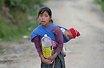 A girl carries her sibling on her back in Tuixcajchis, a small Mam-speaking Maya village in Comitancillo, Guatemala.