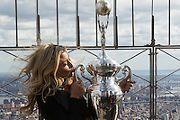 "New York, USA. 23 April 2014.  ""Miss Supercross"" Dianna Dahlgren, kisses the trophy as she promotes the motorcycle race during a visit to the Empire State Building in New York. Photo by Eduardo Munoz Alvarez/VIEWpress"