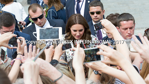 18.07.2017; Gdansk, Poland: DUKE AND DUCHESS OF CAMBRIDGE<br /> receive a warm welcome during the walkabout at the Gdansk Town Market.<br /> The royals will tour both Poland and Germany over the next five days.<br /> Mandatory Photo Credit: &copy;Francis Dias/NEWSPIX INTERNATIONAL<br /> <br /> IMMEDIATE CONFIRMATION OF USAGE REQUIRED:<br /> Newspix International, 31 Chinnery Hill, Bishop's Stortford, ENGLAND CM23 3PS<br /> Tel:+441279 324672  ; Fax: +441279656877<br /> Mobile:  07775681153<br /> e-mail: info@newspixinternational.co.uk<br /> Usage Implies Acceptance of Our Terms &amp; Conditions<br /> Please refer to usage terms. All Fees Payable To Newspix International