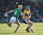 Richie English of  Limerick in action against Cathal Mc Inerney of  Clare during their NHL quarter final at the Gaelic Grounds. Photograph by John Kelly.