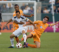 LA Galaxy midfielder Landon Donovan (10) is marked tightly by Puerto Rico Islanders Noah Delgado (5) and Christopher Nurse (8). The Puerto Rico Islanders defeated the LA Galaxy 4-1 during CONCACAF Champions League group play at Home Depot Center stadium in Carson, California on Tuesday July 27, 2010.Puerto Islanders Alexis Rivera (5)