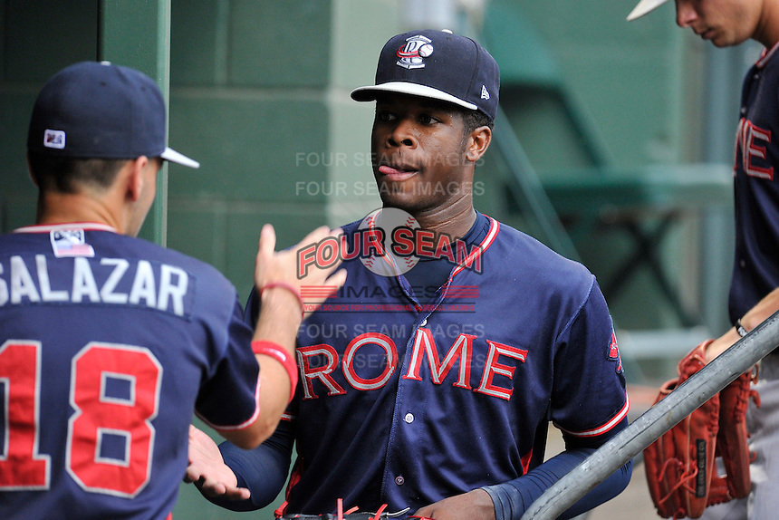 Starting pitcher Touki Toussaint (20) of the Rome Braves is congratulated by Alejandro Salazar (18) a game against the Greenville Drive on Thursday, September 1, 2016, at Fluor Field at the West End in Greenville, South Carolina. Rome won, 3-2. (Tom Priddy/Four Seam Images)