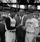 Pittsburgh PA:  Roberto Clemente presenting a trophy to local baseball player from Pleasant Hills before the annual HYPO game at Forbes Field. The money raised by HYPO (Help Young Players Organize) was used to help local communities buy equipment and build ball fields. <br /> Big Jim Daniell, former star college and professional football player is in the background. Daniell Sapp and Boorn did the Public Relations for the HYPO charity baseball game with the Cleveland Indians - 1965