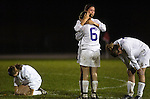18 October 2006--Marion Girls Soccer Regional. Marion High School soccer players Paige Clegg, from left, Ellen Collecod (6), Alex Lester and April Singer, right, react after losing to Fort Wayne Snider on penalty kicks Wednesday night during regional match up at Bellmont High School in Decatur.   PHOTO/Daniel Johnson dhjohnson@marion.gannett.com