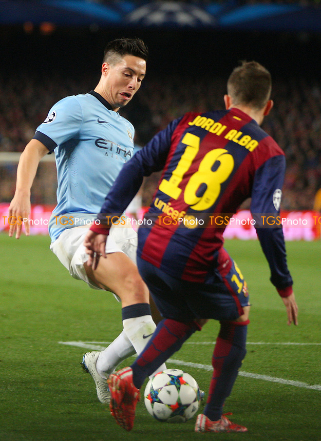 Samir Nasri of Manchester City and Jordi Alba of FC Barcelona - FC Barcelona vs Manchester City - European Champions League Round of Sixteen Football at the Camp Nou Stadium on  18/03/15 - MANDATORY CREDIT: Dave Simpson/TGSPHOTO - Self billing applies where appropriate - 0845 094 6026 - contact@tgsphoto.co.uk - NO UNPAID USE