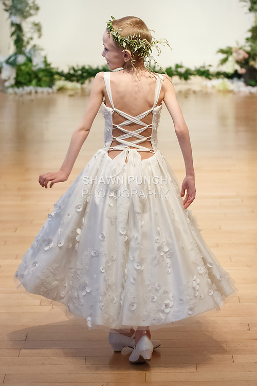 """Sophia Eber walks runway in a bridal gown from the Sarah Jassir 2017 """"The Secret Garden"""" collection on October 8th 2016, during New York Bridal Fashion Week."""