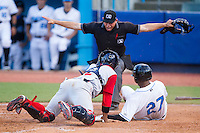 Bralin Jackson (27) of the Hudson Valley Renegades slides across home plate ahead of the tag from Adrian Abreau (2) of the Brooklyn Cyclones as home plate umpire Tyler Olson makes a safe call at Dutchess Stadium on June 18, 2014 in Wappingers Falls, New York.  The Cyclones defeated the Renegades 4-3 in 10 innings.  (Brian Westerholt/Four Seam Images)