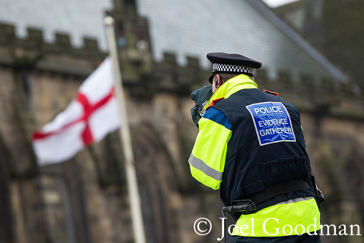 © Joel Goodman - 07973 332324 . 09/06/2012. Rochdale , UK. A police Evidence Gatherer videos the demonstration . The English Defence League ( EDL ) hold a march and rally in Rochdale Town Centre . Photo credit : Joel Goodman