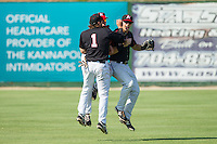 Hunter Jones (1), Jacob Morris (24) and Kale Kiser (9) celebrate their victory over the Hagerstown Suns at CMC-Northeast Stadium on June 1, 2014 in Kannapolis, North Carolina.  The Intimidators defeated the Suns 5-1 in game one of a double-header.  (Brian Westerholt/Four Seam Images)