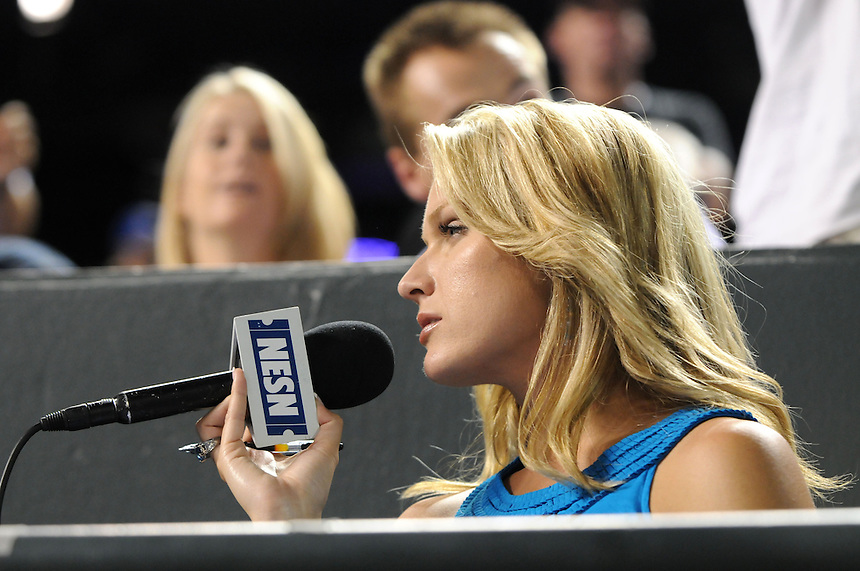 22 JUNE 2010: NESN on-field reporter Heidi Watney reports from the photographer bay during an interleague regular season Major League Baseball game between the Colorado Rockies and the Boston Red Sox at Coors Field in Denver, Colorado. The Rockies beat the Red Sox 2-1.  *****For Editorial Use Only*****