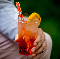 ELMONT, NY - JUNE 09: A fan enjoys an Aperol Spritz on Belmont Stakes Day at Belmont Park on June 9, 2018 in Elmont, New York. (Photo by Kazushi Ishida/Eclipse Sportswire/Getty Images)
