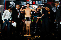 Australia boxer Daniel Geale holds his arms up while he attends the scale during an official weigh-in ahead of his fight against Puerto Rico boxer Miguel Cotto at Barclays Center in New York.  06/05/2015. Eduardo MunozAlvarez/VIEWpress