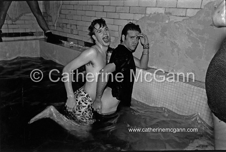 Michael Alig (L) and friend in a basement pool in East Village after hours club Cave Canem, July 18, 1989 at approximately 5:00 am, New York City.<br /> <br /> Copyright Catherine McGann / All Rights Reserved<br /> www.catherinemcgann.com<br /> catherinemcgann@gmail.com