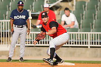 First baseman Dan Black #31 of the Kannapolis Intimidators stretches for a throw at Fieldcrest Cannon Stadium July 26, 2009 in Kannapolis, North Carolina. (Photo by Brian Westerholt / Four Seam Images)