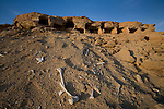 Human remains are visible in the desert sands by tombs on the outskirts of Siwa Town in the Siwa Oasis, Egypt.