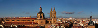 "Panoramic rooftop view of Clerecia Church, Salamanca, Spain, pictured on December 19, 2010 in the afternoon, from the New Cathedral. The Baroque style Clerecia Church, originally the Royal College of the Company of Jesus, was commissioned in the 17th century, from architect Juan Gomez de Mora, by Queen Margarita of Austria, wife of Philip III of Spain. It comprises two sections: the Jesuit school and church, with its three-storey Baroque cloister, and private living quarters for the monks and now houses the Salamanca Pontificia University.  Salamanca, an important Spanish University city, is known as La Ciudad Dorada (""The golden city"") because of the unique golden colour of its Renaissance sandstone buildings. Founded in 1218 its University is still one of the most important in Spain. Around it the Old Town is a UNESCO World Heritage Site. Picture by Manuel Cohen"