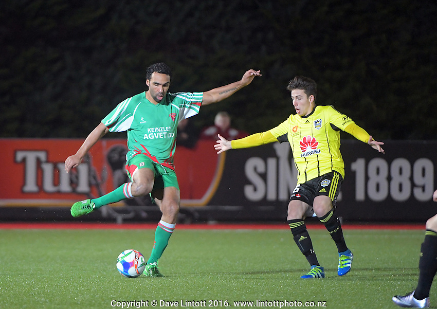 Paul Ifill (left) in action during the A-League preseason football match between Wairarapa United and Wellington Phoenix at Trusthouse Memorial Park, Masterton, New Zealand on Tuesday, 28 June 2015. Photo: Dave Lintott / lintottphoto.co.nz