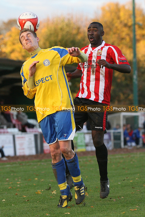 James Hawes of Concord heads clear from Tambeson Eyong - AFC Hornchurch vs Concord Rangers - Ryman League Premier Division Football at The Stadium - 06/11/10 - MANDATORY CREDIT: Gavin Ellis/TGSPHOTO - Self billing applies where appropriate - Tel: 0845 094 6026