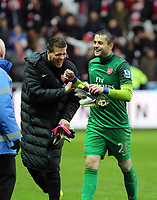 Pictured: Arsenal goalkeeper Lukasz Fabianski (in green) with team mate is laughing off a verbal argument he had with Michu of Swansea (not pictured).  Saturday 16 March 2013<br />